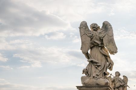 tiber: Berninis marble statue of angel from the SantAngelo Bridge in Rome, Italy