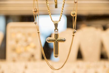 Gold Cross in a Jewelry
