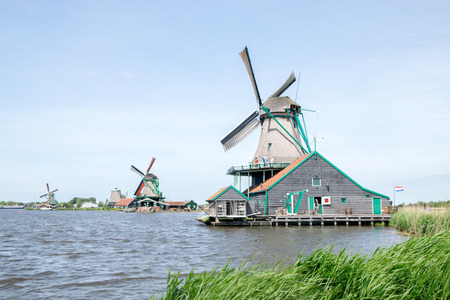 Traditional Dutch windmills with canal near the Amsterdam, Holland