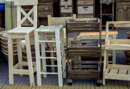 tigre: BUENOS AIRES, ARGENTINA - AUGUST 07, 2017:  Wooden furniture for sale are seen at Puerto de Frutos in Tigre City, Buenos Aires, Argentina Stock Photo