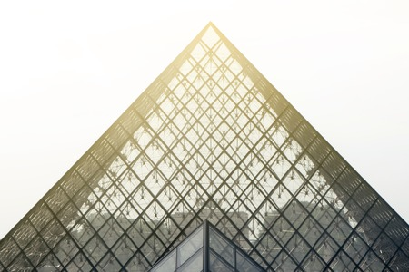 Louvre museum with the famous glass pyramid Editorial