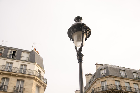Detail of old street lamp in a street in Paris