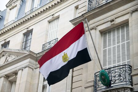 PARIS, FRANCE - JUNE 06, 2017: Flag waving at the Embassy of Egypt in Paris, France