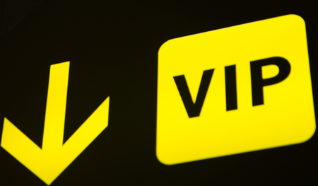 VIP sign arrow on black background Stock Photo