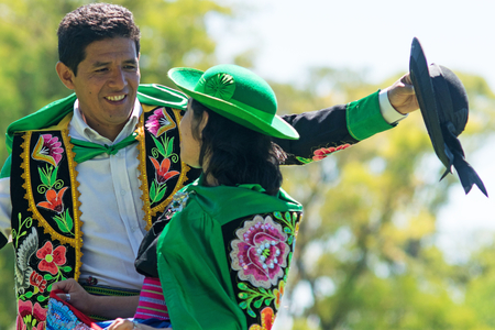 Peruvian couple dancing Huayno, a traditional musical genre typical of the Andean region of Peru, Bolivia, northern Argentina and northern Chile