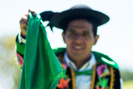 Portrait of a man dancing Huayno, a traditional musical genre typical of the Andean region of Peru, Bolivia, northern Argentina and northern Chile
