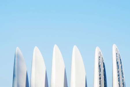 Set of surf boards in a stack by ocean