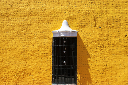 Yellow spanish colonial style wall in Valladolid, Mexico Stock Photo