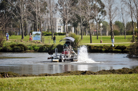 ENTRE RIOS, ARGENTINA - OCTOBER 01: A worker removers weed with an Aquatic Weed Harvester Boat on October 01, 2018 in Entre Rios, Argentina