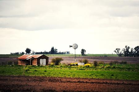 Rural farm and windmill in Entre Rios, Argentina Reklamní fotografie