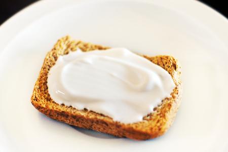 Whole-grain bread toast with cream cheese Archivio Fotografico