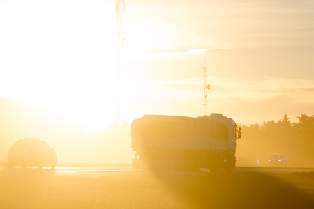 Semi-Truck On Highway at Sunset