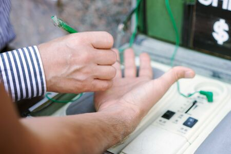 Doctor controlling the energy meridians of a young adult man hand with a reflexology technique Standard-Bild