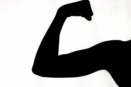 Woman Flexing Arm against white background 写真素材