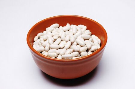 Beans in bowl, Close Up against white background