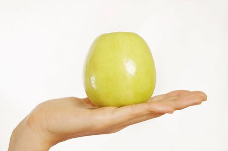 Woman holding green apple in hand