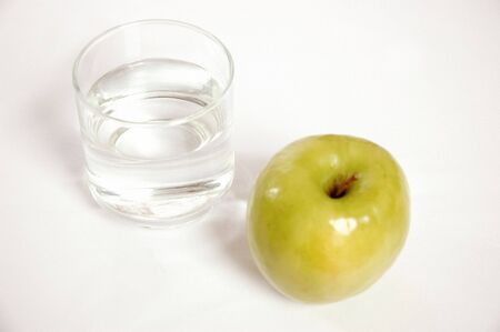 Glass of Water and Green Apple