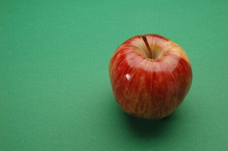 Red Apple, Close Up on green background Stock Photo
