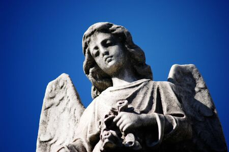 Close View of an Angel Statue Against Blue sky