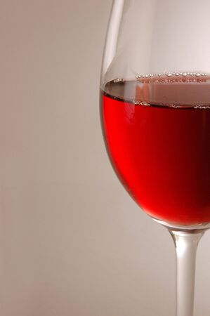 Wine glass containing red wine Stock Photo