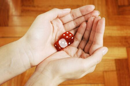 Female Hands holding two red Dice