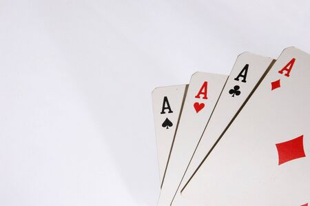 Poker cards with four A on white background