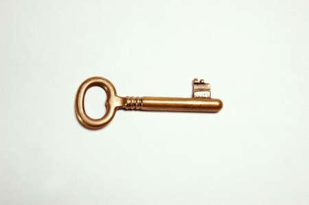 Golden Key against white background