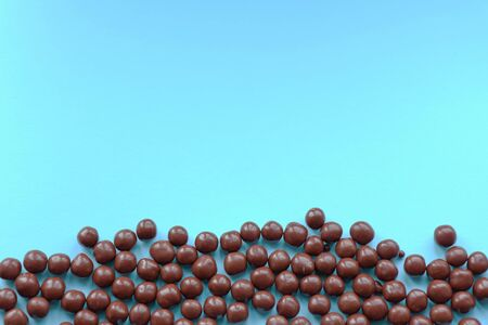 Chocolate balls on a blue background. Top view