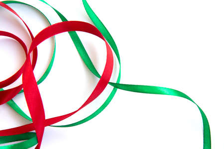 Bright festive red and green ribbon and curl isolated on white background