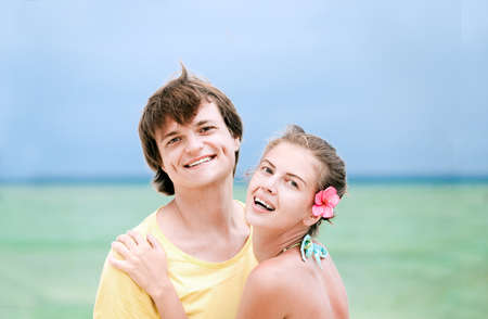 young happy couple having fun on tropical beach  honeymoon photo