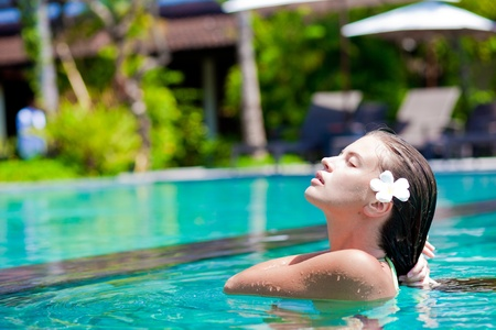 half face: half face portrait of beautiful woman in luxury pool