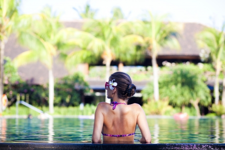portrait of young attraactive smiling woman in luxury pool