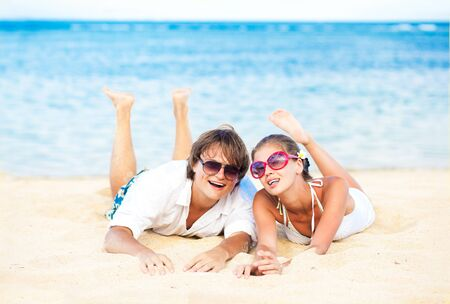 adult indonesia: young loving couple in white on tropical beach. honeymoon