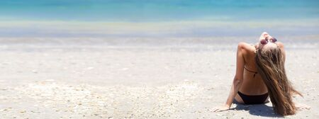 bali beach: lpanorama of ong haired girl in bikini on tropical bali beach