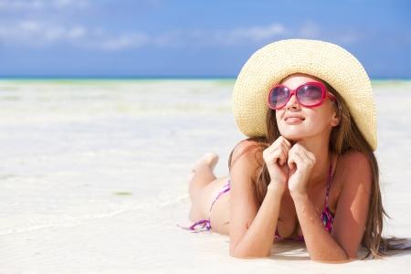 hot girl lying: long haired girl in bikini on tropical bali beach Stock Photo