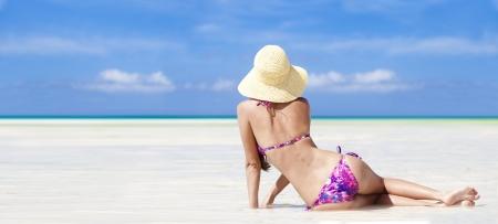 bali beach: long haired girl in bikini on tropical bali beach Stock Photo