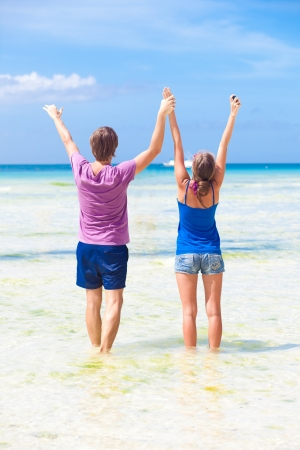 happy young couple having fun on the beach photo