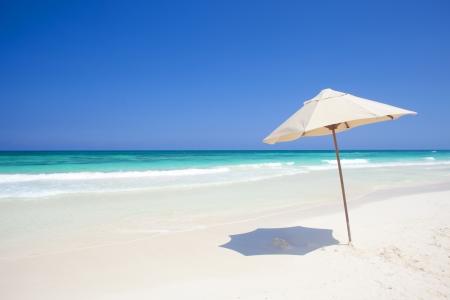 umbrella on a perfect white sand Tulym beach in Mexico