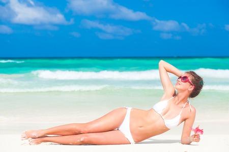 woman beach: Beautiful woman in white bikini on the beach. Travel concept