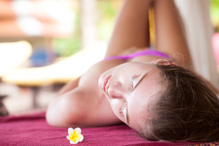 beautiful young woman enjoying her time in tropical spa Stock Photo - 27030523