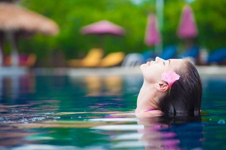 half face: half face portrait of beautiful woman in luxury pool