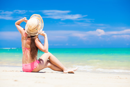 long haired girl in bikini on tropical tthailand beach photo