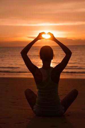 back view of a woman at beach. sunset Standard-Bild