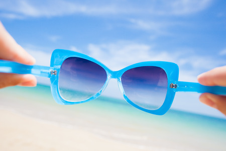 close up of fancy sunglasses. sunny beach in thailand photo