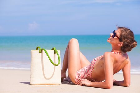 glamourous: beautiful glamourous woman in swimsuit relaxing at tropical beacch