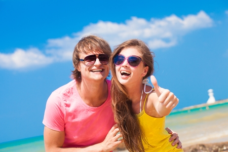 front view of couple having fun at beach photo