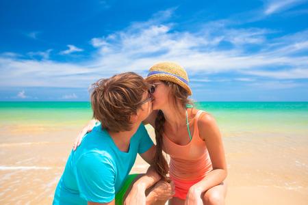 Couple walking and having fun on a tropical beach at Maldives photo