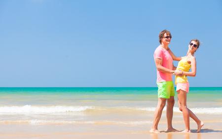 Couple hugging on a tropical beach at Maldives photo