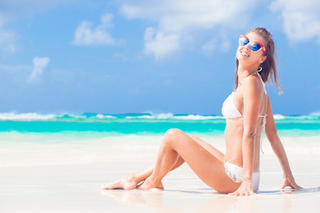 picture of long haired woman in bikini on tropical beach