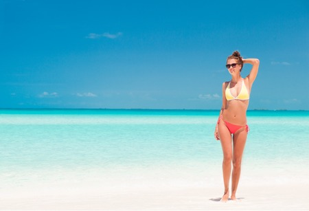 young girl bikini: remote tropical beaches and countries. travel concept